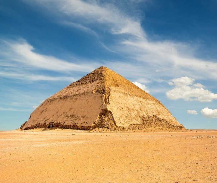 Pyramid under puffy clouds - mazada tours