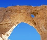 Timna Park The Big Arch with blue sky - Mazada tours